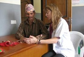 A Physiotherapy Elective volunteers works with a patient at a placement in Nepal