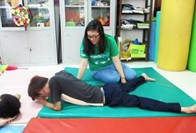 An intern works on a therapy technique with a patient during her Physiotherapy Elective in Vietnam.