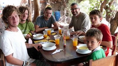A family on a Projects Abroad volunteer trip to Ecuador enjoying their breakfast