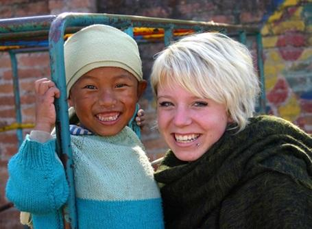 Female volunteer with a child in a care placement in Nepal