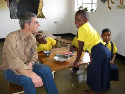 Projects Abroad Care volunteer talks to children at his placement in Tanzania