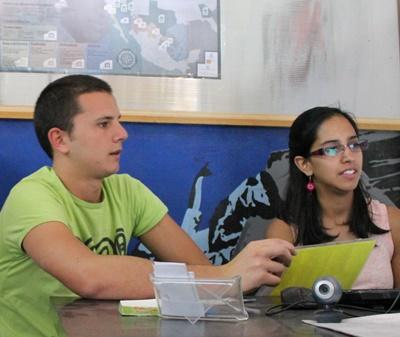 Two International Development volunteers in their office in Mexico
