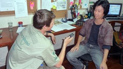 A Projects Abroad Journalism volunteer interviews for his article