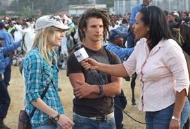 A journalism volunteer interviews people on location in Ethiopia