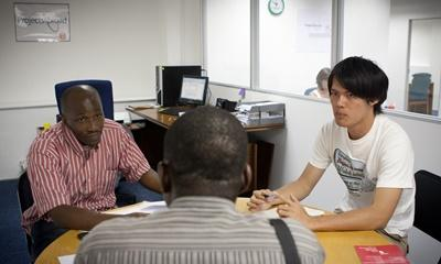 Law & Human Rights volunteer assists with a client consultation