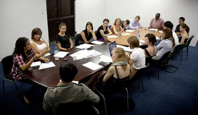 Volunteers and staff members hold a meeting