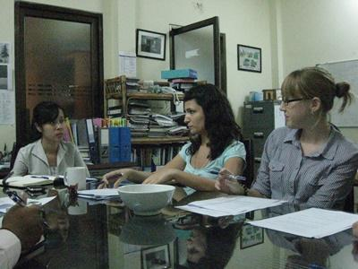 Volunteers hold a meeting in Cambodia