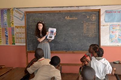 Volunteer gives a human rights talk to children in Jamaica