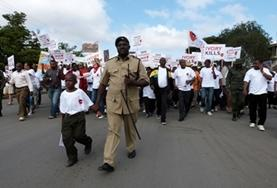 Human Rights interns and local legal staff in Tanzania come together for a march to protest human rights violations against women and children.