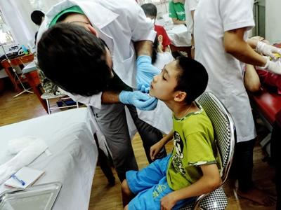 A volunteer in Vietnam examining a child during a medical placement