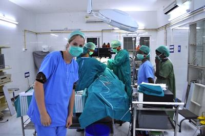A medical intern shadows a team of surgeons during an operation in India.