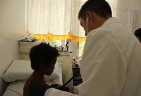 Medical volunteers examine a patient's file at our Medicine internship in the Philippines.