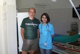 A Medicine volunteer poses with a colleague at a placement in Romania
