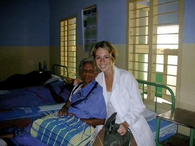 A volunteer nursing student with one of her senior patients in India.