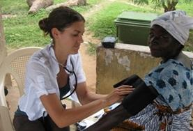 A local women has her blood pressure measured by a Nursing intern assisting at our volunteer placement in Ghana.