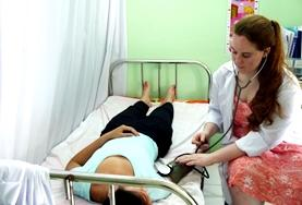 A Nursing volunteer inspects a patient at a placement in Morocco