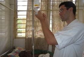 A Nursing intern assists with the care and treatment of patients at a local hospital in Togo.