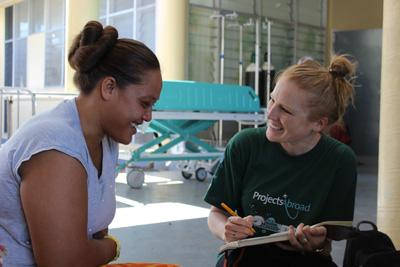 A volunteer talks to a patient