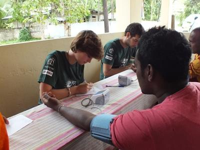 A Sri Lankan man has his blood pressure measured by a Projects Abroad Public Health volunteer.