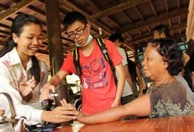 Volunteers interact with patients on a Public Health outreach in Cambodia