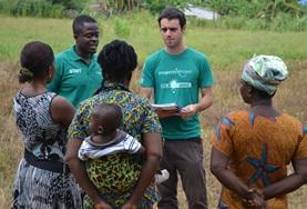 Volunteers talk to locals on a Micro-finance Project in Ghana