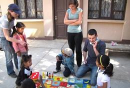 Social Work volunteers in Bolivia interact with children at their placement