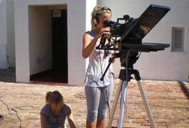 Journalism volunteers operate filming equipment