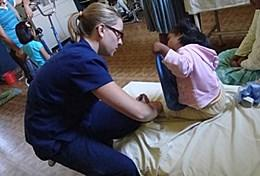 A professional Physiotherapist works through a treatment regime with a young child at our volunteer placement in Bolivia.