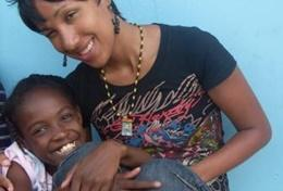A qualified Physiotherapist volunteering in Jamaica works with a child in a local hospital.