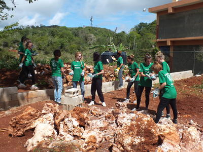 Projects Abroad Easter Building volunteers clear a space for a home in Jamaica