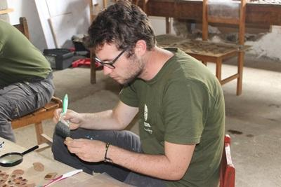 A Projects Abroad volunteer at the Inca project cleaning the ceramics found on the site