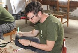 A High School Special Archaeology intern catalogues the artifacts found during a dig in Peru.