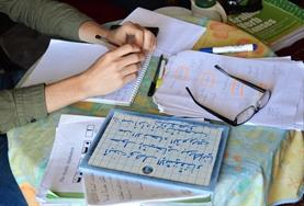 A Care and Arabic Project volunteer takes notes during his language lesson in Morocco