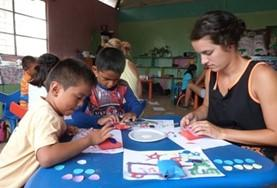 A high school student volunteering in Ecuador runs an art class with children from a local care centre, teaching them new skills in a creative way.