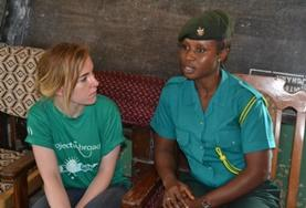 A Human Rights High School Special volunteer interviews a local Ghanaian official as part of her research.