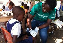 A Public volunteer gains experience doing health screenings during her high school internship in Ghana.