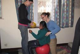 Physiotherapy volunteers work with a patient at a placement in Nepal