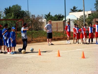 A volunteer coaches a local soccer team in Morocco