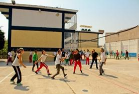 Sports volunteers work with school children during a physical education lesson in Mexico.