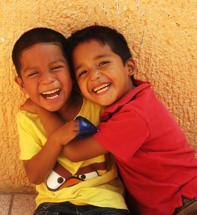 School boys smiling and hugging in Belize