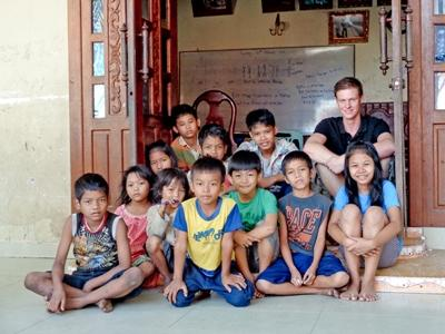 A Teaching volunteer with his class in Cambodia