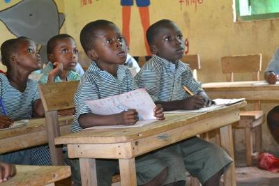 Local children learn in a school in Ghana, Africa