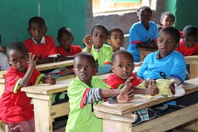 A group of children camera during class at a local school in Madagascar