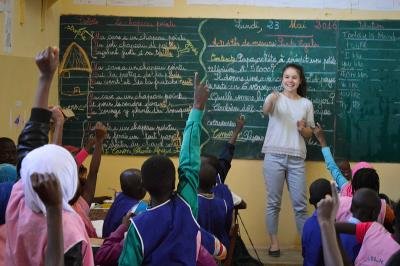 A Projects Abroad volunteer working with students at a school in Senegal