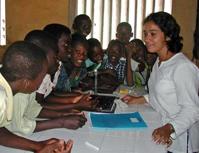 A volunteer chats to a group of eager students in Togo, Africa.