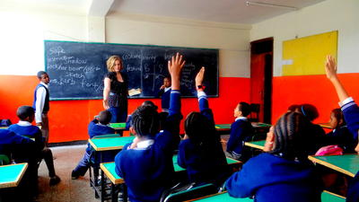 A Projects Abroad volunteer teaches French to a group of children