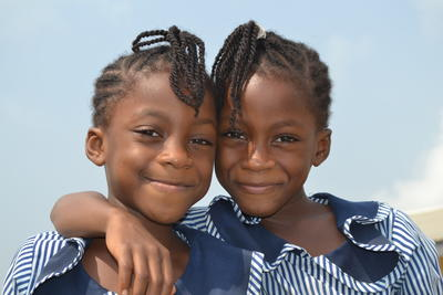 Two girls benefiting from our volunteer IT teaching project in Ghana