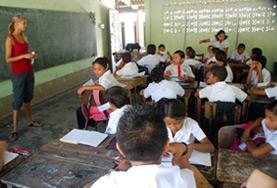 A volunteer teaches an English lesson to a class of local students during her Teaching Project work in Costa Rica.