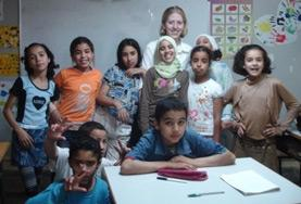 A Teaching volunteer poses with students at her placement in Morocco