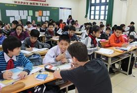A Teaching volunteer conducts a lesson to improve students' English language skills at a school in Vietnam.